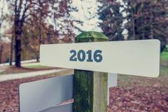 segno 2016 su un'insegna di legno Immagine Stock