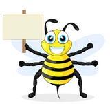 Segno sveglio di legno della holding dell'ape Immagine Stock