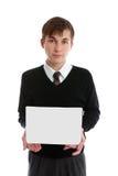 Segno teenager della holding del ragazzo, libro o l'altro oggetto Fotografia Stock