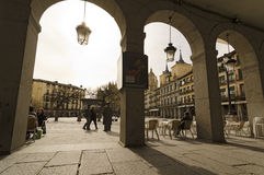 Segovia, arcades. SEGOVIA, SPAIN - MARCH 3, 2013: People in main square in Segovia. With the nearby Madrid, Segovia is a popular destination for small-scale Royalty Free Stock Photography