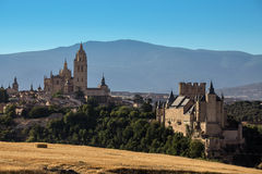 Segovia Cathedral and Alcazar - Spain. Late afternoon sunlight on Segovia Cathedral (dates from 1525) and the Alcazar of Segovia in the Castila-y-Leon region of Stock Photography