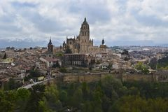 Segovia Cathedral, Spain. A view of the Segovia Cathedral, the historic part of the town, and the Guadarrama mountains stock images