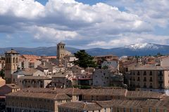 General view of Segovia with snowy mountains in the background royalty free stock photos