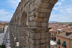 Segovia roman aqueduct. Castile region, Spain. The ancient roman aqueduct of Segovia and town view. Azoguejo square. Castile region, Spain Stock Photos