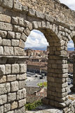 Segovia Roman Aqueduct. View of the old town through an arch of the roman aqueduct in Segovia, Spain Royalty Free Stock Image