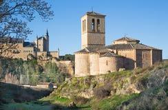 Segovia - The romanesque church Iglesia de la Vera Cruz and Alcazar. Stock Images