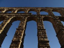 Segovia`s Aqueduct seen from the ground royalty free stock images