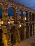 Segovia, Spain at the ancient Roman aqueduct. The Aqueduct of Segovia, located in Plaza del Azoguejo, is the defining historical f stock image