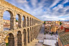 Segovia, Spain at the ancient Roman aqueduct. Segovia, Spain town skyline at the ancient Roman aqueduct stock image