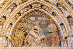 SEGOVIA, SPAIN, APRIL - 14, 2016: The relief of pieta on the portal in atrium of the Cathedral by Juan Guas 1483 Royalty Free Stock Photography