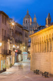 SEGOVIA, SPAIN, 2016: Calle Juan Bravo street and the Cathedral in the background at dusk. Royalty Free Stock Image