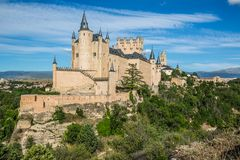 Segovia, Spain. The famous Alcazar of Segovia, rising out on a r. Ocky crag, built in 1120. Castilla y Leon stock images