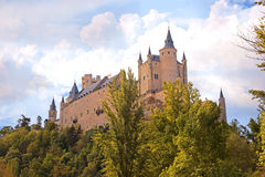 Segovia, Spain. The famous Alcazar of Segovia, rising out on a rocky crag, built in 1120. Castilla y Leo. Royalty Free Stock Photography