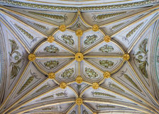 SEGOVIA, SPAIN, 2016: The gothic vault of side chapel in Cathedral of Our Lady of Assumption with the neoclassicistic frescoes. Royalty Free Stock Photo