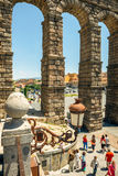 Segovia, Spain - June 29, 2014: People around the famous ancient roman aqueduct Royalty Free Stock Photos