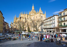 SEGOVIA, SPAIN, 2016: The Plaza Mayor square and the morning market and the Cathedral at morning. Royalty Free Stock Photo