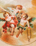 SEGOVIA SPANIEN: Freskomålning av änglar med radbandet i domkyrka av vår dam av antagandet och kapellet vår dam av radbandet Royaltyfri Fotografi