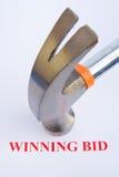 segra för auktionanbud arkivbild