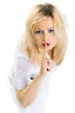 Segredo. A mulher mostra o hush. Fotografia de Stock