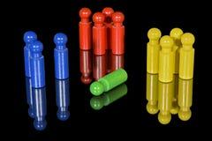 Segregacja kolorem reprezentuje drewnianymi czopami Fotografia Royalty Free