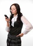 Segretaria con il cellulare isolato su bianco Fotografia Stock Libera da Diritti