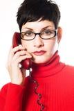 Segretaria nel colore rosso fotografie stock