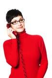 Segretaria nel colore rosso fotografie stock libere da diritti
