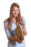 Segretario femminile che legge un'annotazione Immagini Stock