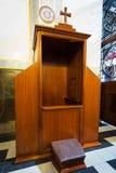 Segreto di una confessione catholicism immagine stock