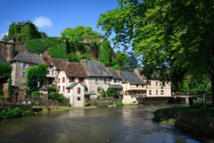 Segur-le-Chateau, medieval village in France. The medieval village of Segur-le-Chateau with half-timbered houses and a castle at the border of Auvezere river in royalty free stock photography