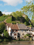 Segur le Chateau village and Auvezere river, France. Segur le Chateau has been selected as one of the most beautiful villages of France, with castle ruins dating stock photo