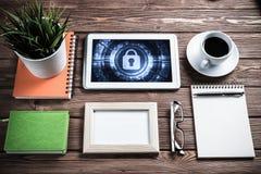 Segurança da Web e conceito da tecnologia com o PC da tabuleta na aba de madeira Fotografia de Stock Royalty Free