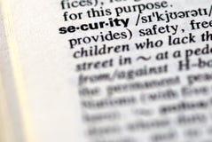 A segurança da palavra em um dicionário Imagens de Stock Royalty Free