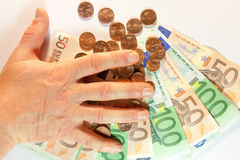 Segurando o dinheiro Imagem de Stock Royalty Free