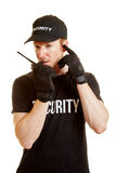 Segurity man alerts his team via radio Royalty Free Stock Photos