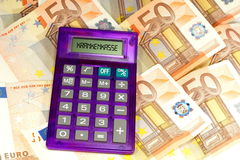 Seguro médico, calculadora y dinero Imagen de archivo