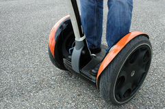 Segway. Someone in jeans standing on segway royalty free stock images