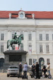 Segway tour excursion in front of statue of Joseph II on Josefplatz square in Vienna Stock Images