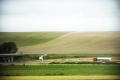 Sehen Sie Landschaft und Stadtbild der Landschaft vom Zugbetrieb an Lizenzfreies Stockfoto