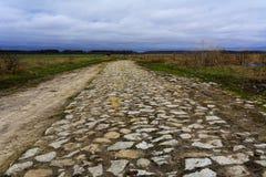 Sehr alte Straße von den Pflastersteinen Lizenzfreie Stockfotografie