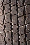 Sehr altes benutztes schwarzes Reifenmakrofoto Stockfotografie