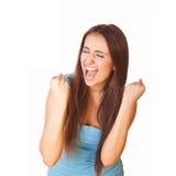 Sehr aufgeregte Frau zusammengepreßte Fäuste Stockfotografie