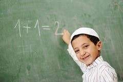Sehr nettes und positives Kindlächeln Lizenzfreie Stockfotos