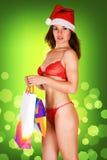 Sehr reizvolles Mädchen der Mrs Weihnachtsmann in der roten Unterwäsche Lizenzfreies Stockfoto