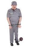 Sehr trauriger Gefangener mit Klotz am Bein Lizenzfreies Stockbild