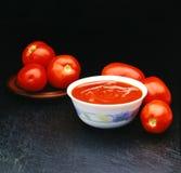 Sei pomodori dei pomodori per un souce Fotografia Stock Libera da Diritti