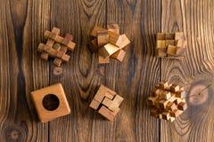Sei puzzle di legno delle complessità differenti immagini stock libere da diritti