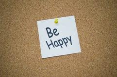 Seien Sie glückliches Post-It Stockfoto