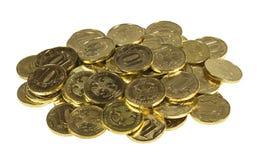 Seifenerzmünzen auf einem weißen Hintergrund Lizenzfreie Stockfotografie