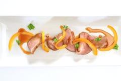 Sein de canard avec de la sauce orange Images libres de droits